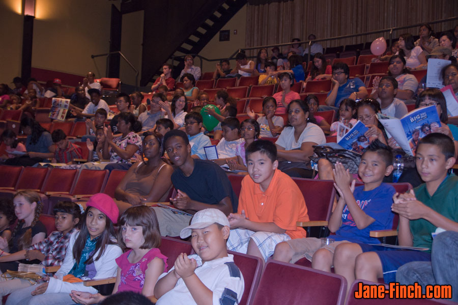 Children from the Jane-Finch community inside York Woods Public Library Theatre for Big Day Out