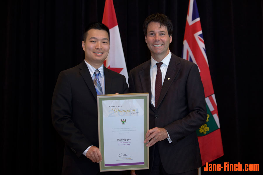 Paul Nguyen recieves the 2011 Newcomer Champion Award from Minister of Citizenship and Immigration, Hon. Dr. Eric Hoskins
