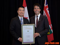 Paul Nguyen recieves the Newcomer Champion Award from Hon. Dr. Eric Hoskins, Ontario Minister of Citizenship and Immigration