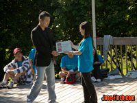 Paul Nguyen receives certificate of appreciation from First Step Camp