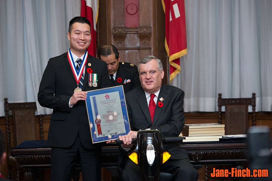 Paul Nguyen receives the National Ethnic Press award from the Lt. Gov. of Ontario, David C. Onley