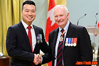 Paul Nguyen receives the Meritorious Service Medal from Governor General David Johnston