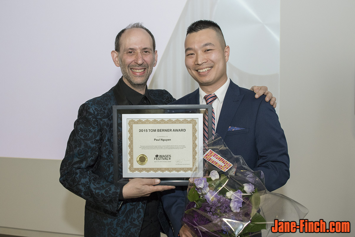 Paul Nguyen receives the 2015 Tom Berner Award from Images Festival executive director Scott Miller Berry