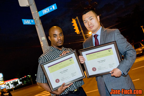 Paul Nguyen and Chris Williams receive the Ontario Volunteer Service Award.